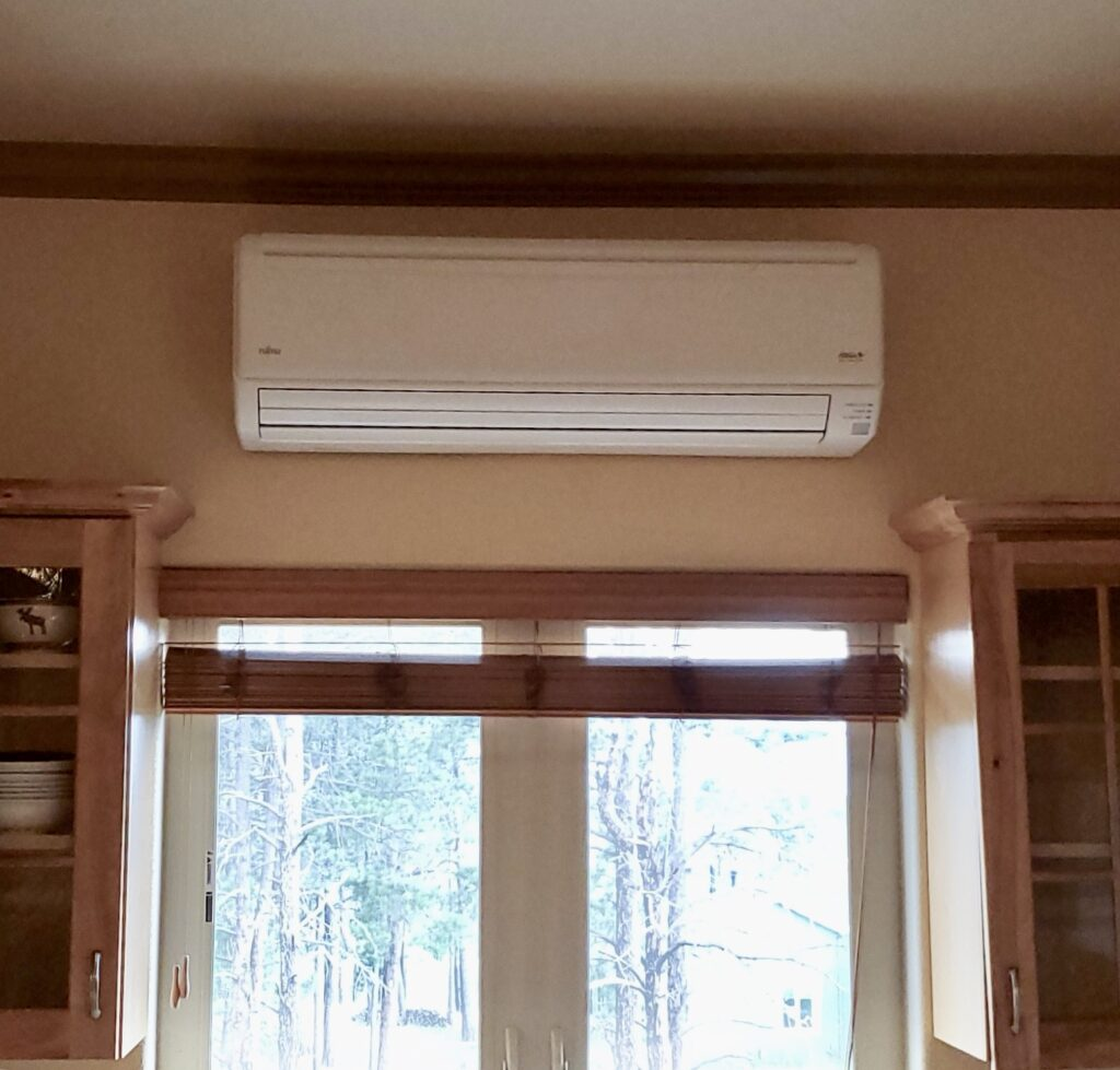 mini split interior unit on wall near ceiling
